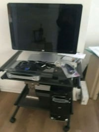 black flat screen TV; white wooden TV stand Simi Valley, 93065