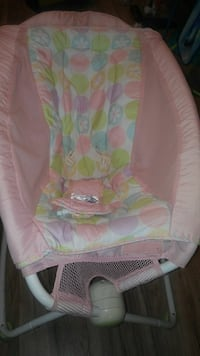 toddler's pink, white, and green polka dotted rock and play sleeper