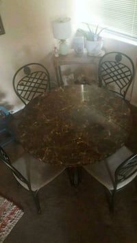 round brown wooden table with four chairs dining set Silver Spring, 20904