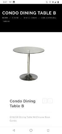 Stainless steel base glass top table