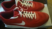 pair of red Nike running shoes