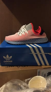 unpaired white and red Adidas low top sneaker on box Acton, 93510