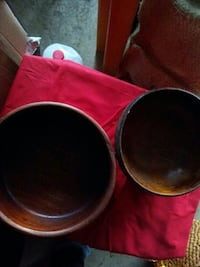 two brown wooden bowls