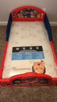 toddler's red and blue Paw Patrol bed frame