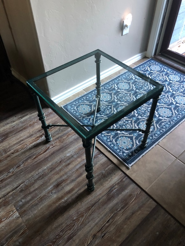 Heavy greenish metal with glass top side table.