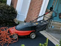 red and black push mower in moving sale 22 km