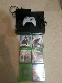 Xbox One console with controller and game cases Edmonton, T6W 0G8