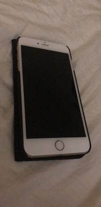 Gold iPhone 6 Plus with black case 552 km