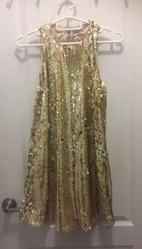 """NEW w/tag Ladies Sz. XS Gold sequinned Lined dress. Measures 35"""" Long from top of shoulder to bottom. Reg. Price of dress was $88.00 but I paid $72.32 ($64.00 + $8.32 txs). Selling for $35.00. Excellent Condition. Smoke/Pet Free Home"""