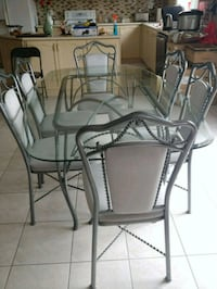clear glass-top table with gray steel base and chairs Brampton, L6P 1K6