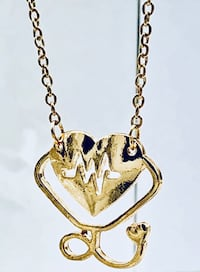 Gold coloured heartbeat adjustable necklace Brampton, L6R 1X5