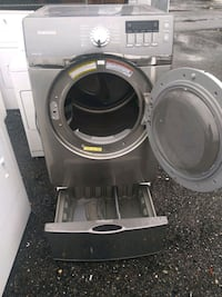 Samsung front load heavy duty steam dryer with pedestal works good  Prince George's County, 20746