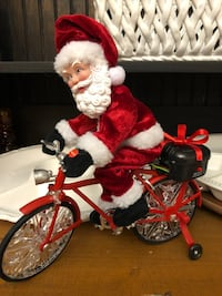 Santa on Bicycle lights up, plays music and the wheels spin.
