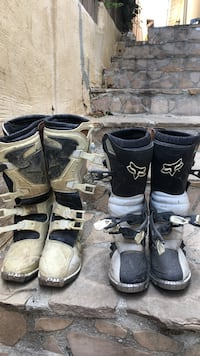 two pairs of black-and-white racing boots Thousand Oaks, 91360