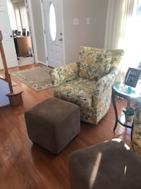 Set of 2 swivel chairs with coordinating ottomans. Centreville, 20120