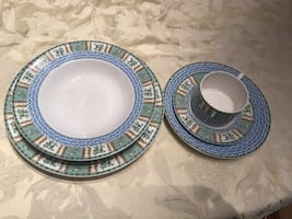 White and blue printed ceramic plates and mugs