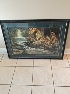 Very nice leopard print picture green border black frame 44 w X 30 L comes from a smoke free home