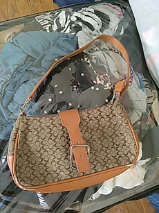 white and brown leather monogram Coach hobo bag