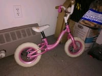 toddler's pink and white bicycle Vancouver, V6A 3L2