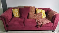red fabric 3-seat sofa with throw pillows 63 km