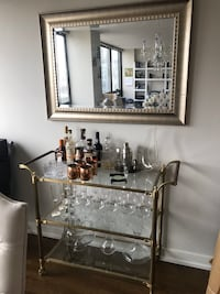Gold rimmed wall mirror