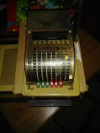 brown and grey dollars CTS adding machine