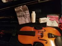 3/4 violin with case and extra strings