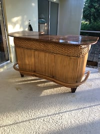 Brown wooden framed glass top coffee table Safety Harbor, 34695