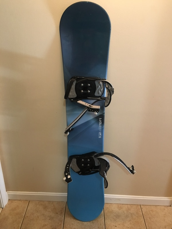 Black and blue snowboard with bindings