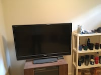 black flat screen TV with remote Germantown, 20874