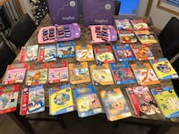 2 leappads learning systems with 26 books and cartridges  Edmonton, T6H 3A8