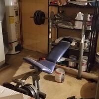Weight bench with bar and weights 4 15lb and 2 10lb included