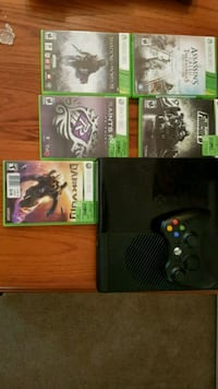 black Xbox One console with controller and game cases North Vancouver, V7J 1R1