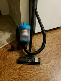 blue and black vacuum cleaner 3158 km