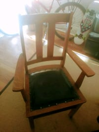 black wooden frame black leather padded chair Toronto, M6G 2Z2