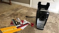 black and gray Keurig coffeemaker used about 3 times - excellent condition with manual and red cup is reusable , fill it with the coffee you like . Grayson, 30017