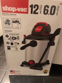 black and red Black & Decker vacuum cleaner box 43 km