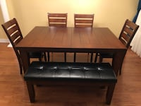 rectangular brown wooden table with four chairs dining set Toronto, M6M