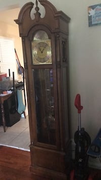 Brown wooden framed grandfather clock