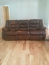 Dual reclining brown leather 3 seat sofa  Palm Coast, 32137