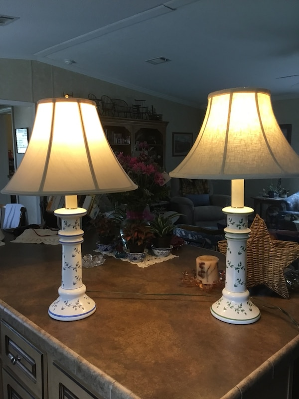 two white table lamps with beige shades