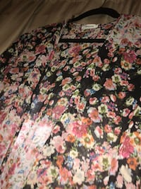 black, pink, and white floral textile 48 km
