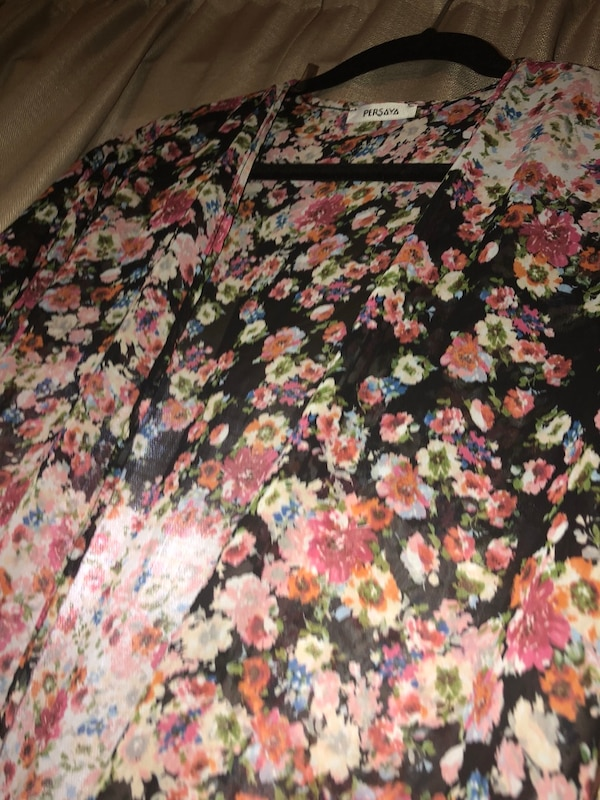 black, pink, and white floral textile