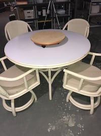 Dining Table and 4 swivel chairs, bamboo with mica top, and cane back swivel chairs. Narragansett, 02882