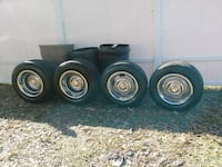 4 black car wheel with tires