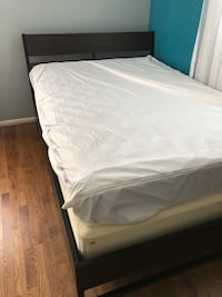 White mattress and black wooden bed frame Gaithersburg, 20882