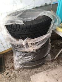 black vehicle wheel set like new only used for two months . They are a great tire