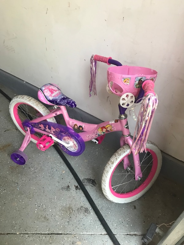 Girl pink and purple bicycle with training wheels