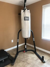 Punching bag with stand and two sets of gloves