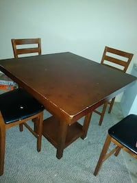 rectangular brown wooden table with four chairs dining set Frederick, 21703